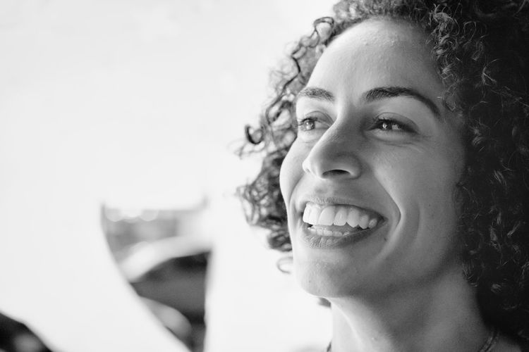 Leisure Activity Focus On Foreground Hairstyle Close-up Young Adult Lifestyles Toothy Smile Emotion Happiness One Person Smiling Portrait Headshot Cheerful Looking Away Teeth Curly Hair Real People Adult Beautiful Woman Human Face Blackandwhite