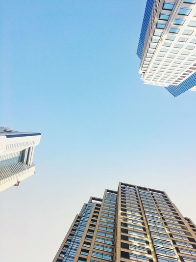 Architecture Building Exterior Built Structure Skyscraper Low Angle View Tall - High The Graphic City City Day Copy Space Tower Clear Sky Modern Tall Outdoors City Life Travel Destinations No People Blue Sky Colour Your Horizn