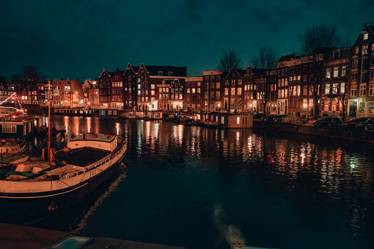 Waters of Amsterdam Canal at night reflecting city lights Architecture_collection Holland Netherlands Amsterdam Water Reflections Amsterdam Canal Water City Street Cityscape Urbanphotography Architecture Building Exterior Built Structure Illuminated City Reflection Night Building Waterfront Nautical Vessel No People Nature Transportation Canal Residential District Mode Of Transportation Sky Outdoors