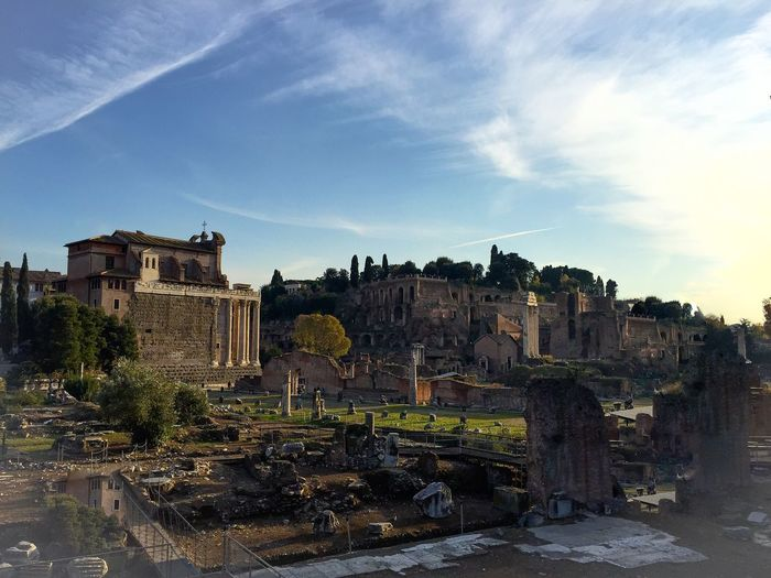 Old ruins against cloudy sky at roman forum