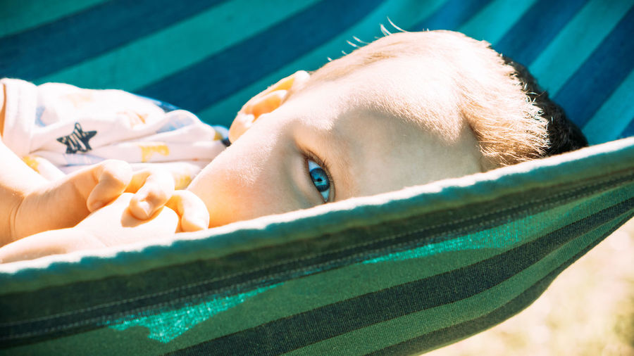 Close-up portrait of young woman in swimming pool