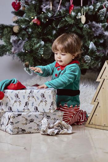 Boy in christmas tree