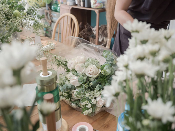 Midsection of florist working at shop