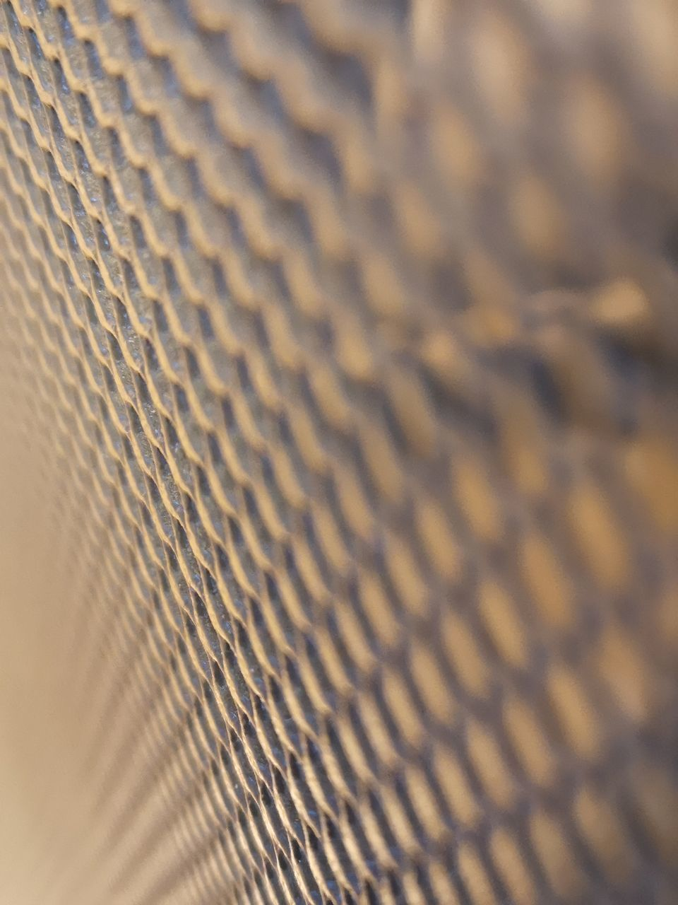 backgrounds, full frame, pattern, selective focus, textured, close-up, no people, repetition, metal, grid, abstract, indoors, textile, technology, still life, brown, high angle view, music, detail