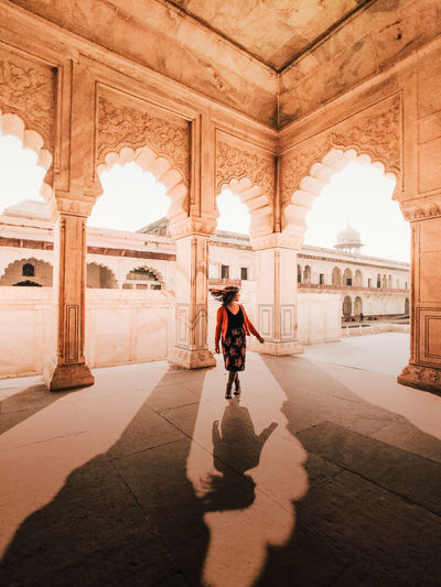 Woman walking in historic building