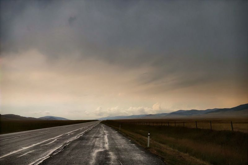 Wet end of the Cowboy Trail. Road No People Tranquil Scene Outdoors Landscape Transportation Highway Wet Grey Day Rural The Way Forward The Road Ahead Southern Alberta Tranquility Scenics