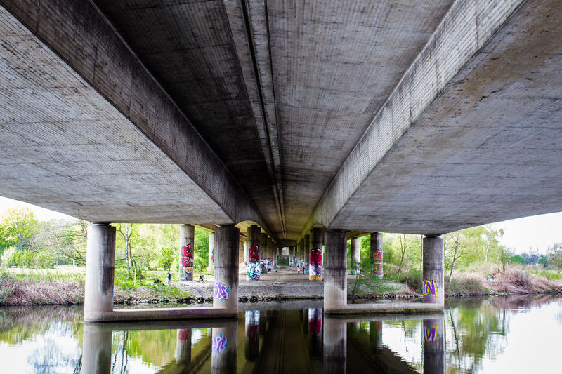 Concrete Adventures - captured in Mülheim ann der Ruhr with my DSLR - (c) Nidal Sadeq 2018 Urban Geometry Adventures In The City Arch Bridge Architectural Column Architecture Below Below The Surface Bridge Bridge - Man Made Structure Built Structure Ceiling Concrete Connection Day Nature No People Overpass Reflection River Symmetry Transportation Underneath Water Waterfront