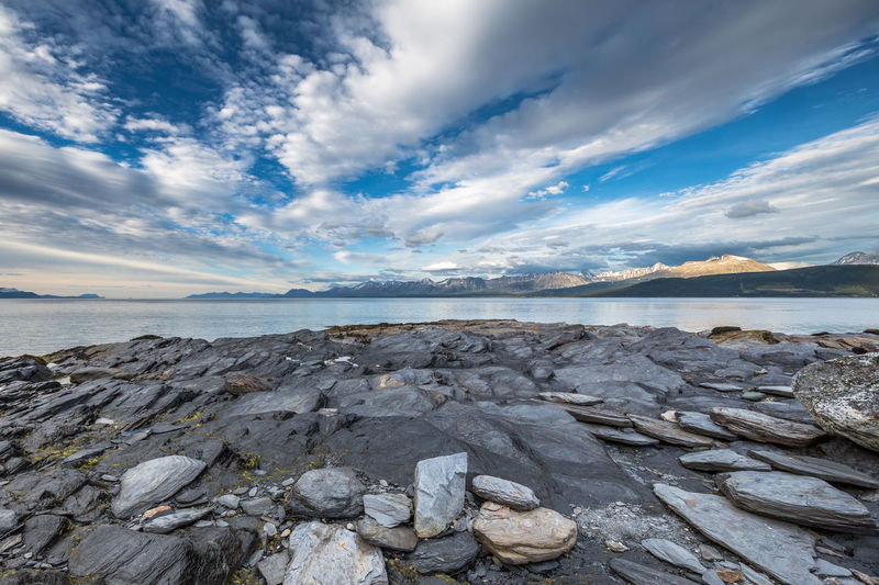 Beauty In Nature Cloud Cloud - Sky Cloudy Dramatic Sky Horizon Over Water Idyllic Lyngen Alps The Great Outdoors - 2017 EyeEm Awards Nature No People Northern Norway Norway Outdoors Remote Rock Rock - Object Rock Formation Sea Shore Sky Stone - Object Tranquil Scene Tranquility Water