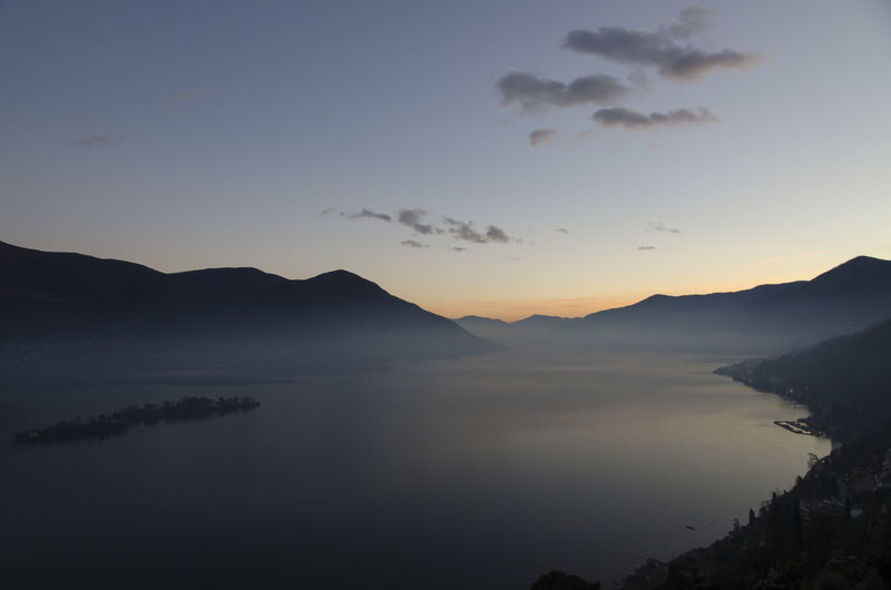 Alpine lake Maggiore with Mountain in Dusk in Ticino, Switzerland. High Up Alpine Lake Beauty In Nature Beauty In Nature Dawn Dusk Elevated View Idyllic Lake Lake Maggiore Landscape Mountain Mountain Range Nature No People Outdoors Romantic Sky Scenics Silhouette Sky Swiss Alps Tranquil Scene Tranquility Water
