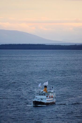 Water Nautical Vessel Transportation Sea Sky Mode Of Transportation Cloud - Sky Nature Beauty In Nature Travel Sunset Scenics - Nature No People Mountain Outdoors Waterfront Tourism Craft Day Passenger Craft