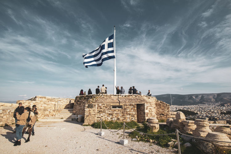 Acropolis Athens Greece Acropolis Architecture History Sky The Past Built Structure Cloud - Sky Travel Destinations Nature Ancient Travel Flag Group Of People People Tourism Building Exterior Old Ruin Patriotism Day Ancient Civilization Outdoors Ruined Archaeology