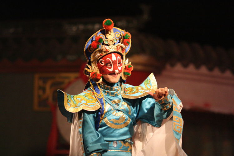 Close-Up Of Woman In Costume Standing On Stage