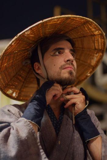 Close-up of man wearing hat