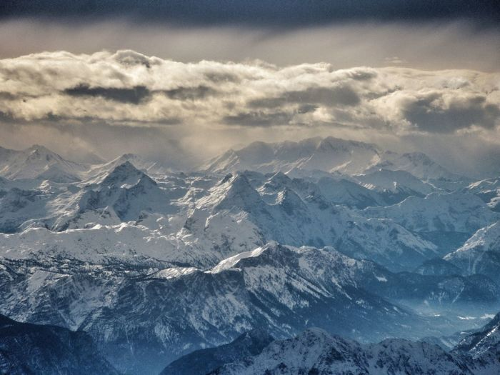 Scenic View Of Snow Covered Mountain Range With Sky