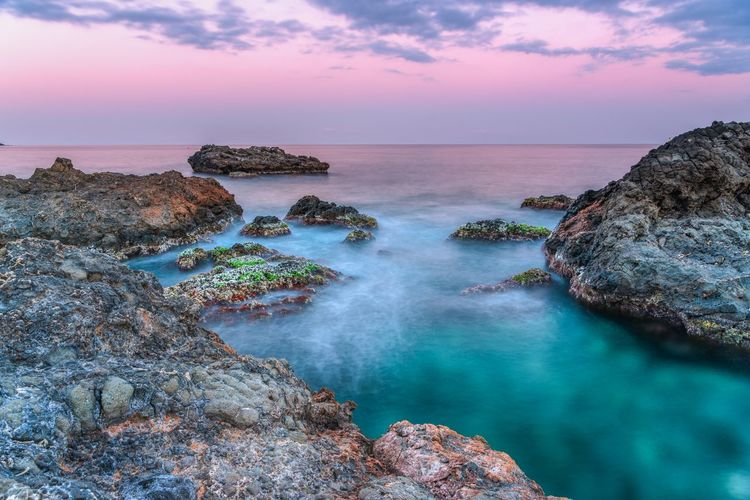 basalt and water Water Beauty In Nature Scenics - Nature Rock Rock - Object Sky Sea Solid Tranquil Scene Horizon Over Water Horizon Tranquility Idyllic Nature Rock Formation Sunset No People Land Non-urban Scene Outdoors Rocky Coastline Eroded