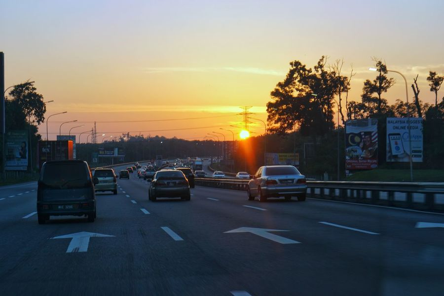 Car Sunset City No People Outdoors Sky Cityscape Day Highway Road Street On Drive Sun Sunrise Summer Vacations Travel Destinations Travel Moving Forward Flares In Nature Traffic Malaysia Days
