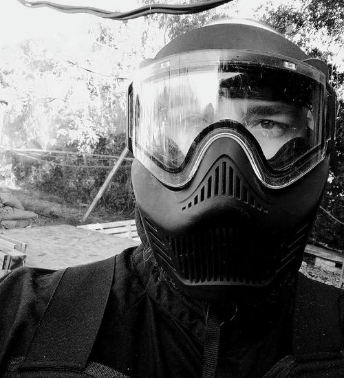 One Person Front View Close-up Only Men One Man Only Men Adult People Outdoors Paintball War Simulated Shooting Simulated War Mask Masked Soldat Blackandwhite Black Mask Shooter