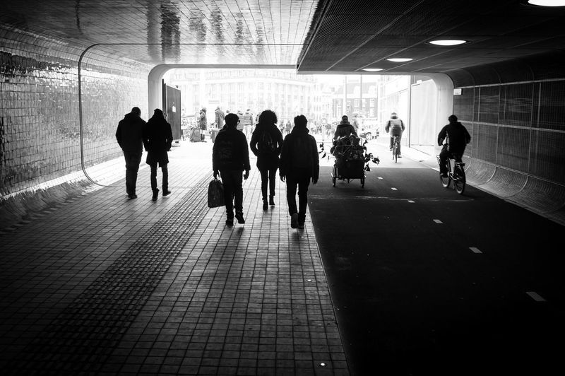 Walk the walk. 👣 Amsterdam Streetphotography Street City Urban Blackandwhite Monochrome EyeEm Best Shots - Black + White Tunnel Light And Shadow Vintagelens Tokina People Watching Taking Photos Traveling Springtime Urbanphotography Photography In Motion Things I Like Showcase April Your Amsterdam Up Close Street Photography The Street Photographer - 2016 EyeEm Awards Found On The Roll