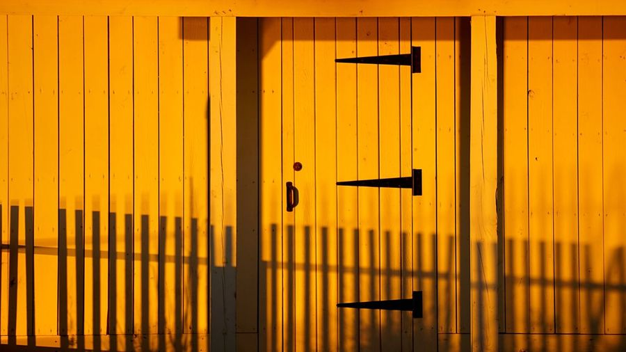 The door in the shadows Fence Door Shadows Lightandshadow Light And Shadow Picketfence Jones Point Park Jones Point Light Sunrise Golden Warm Sunlight Magic Hour