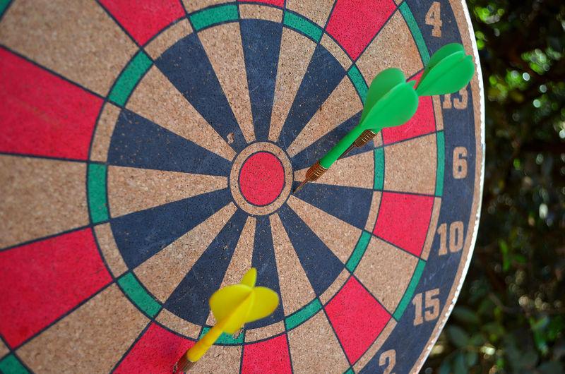 Close-up of arrows on dartboard