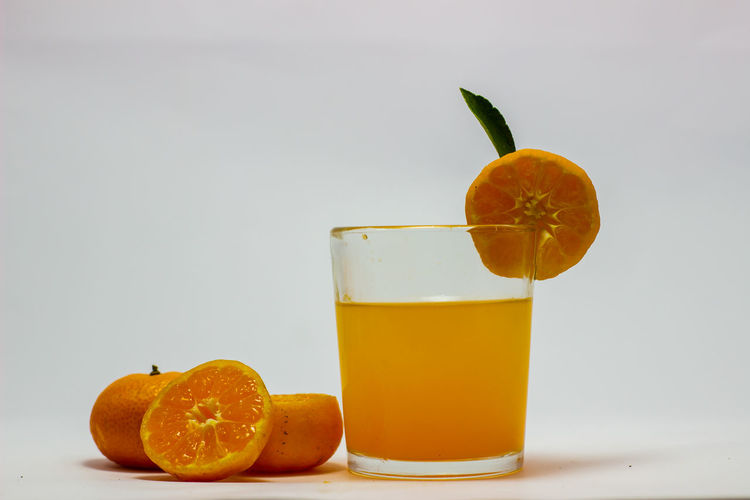 Orange fruit and drink on table