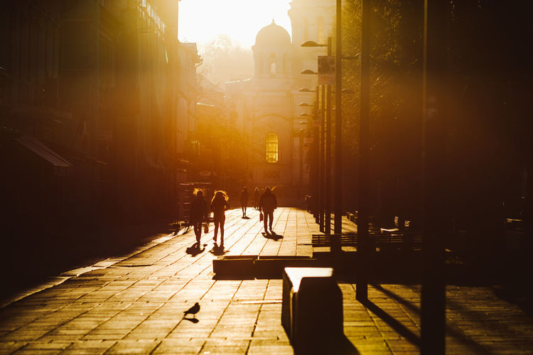 Silhouette Of People In City Street