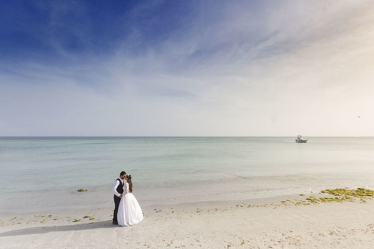 Photo session carried out after the wedding to a couple on the beach
