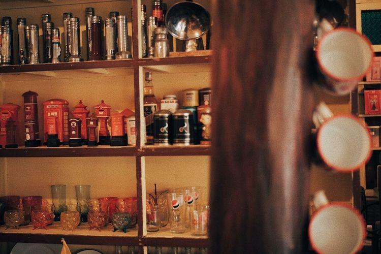 Bottles on shelf in bar