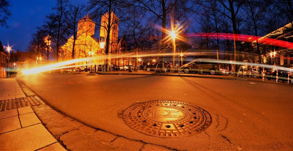 Münster cathedral at night Church Architecture Church Manhole  Manhole Covers Religious Architecture Illuminated Night City Tree Street Architecture Glowing Motion Nature Transportation Building Exterior Blurred Motion Built Structure No People Lighting Equipment Long Exposure Sky Road Outdoors