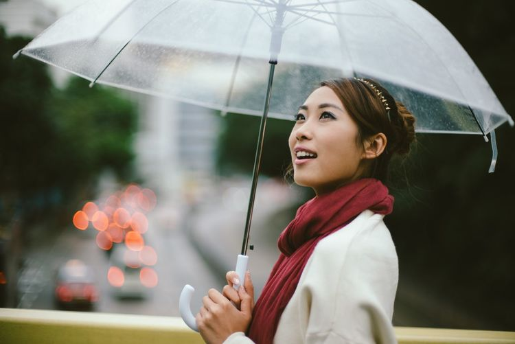 Hanging Out Vibes Beautiful Woman Decision Focus On Foreground Lifestyles Look For Good Looking Forward One Person Positive Emotion Rain Umbrella