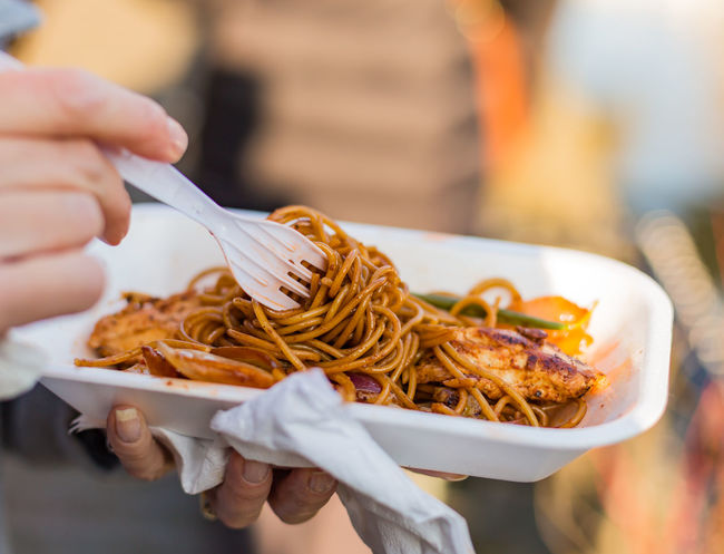 Bowl Close-up Cropped Eating Focus On Foreground Food Freshness Holding Indulgence Leisure Activity Lifestyles Meal Noodles Part Of Person Ready-to-eat Selective Focus Unrecognizable Person Street Food Worldwide