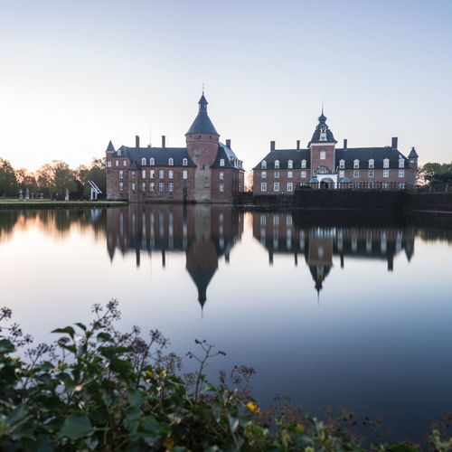 The water castle of Anholt at 5am with a perfect mirror... Anholt Castle Deutschland Germany Mirror Morning Nature No People Outdoors Reflection Schloss Sky Sunrise Travel Destinations Tree Water