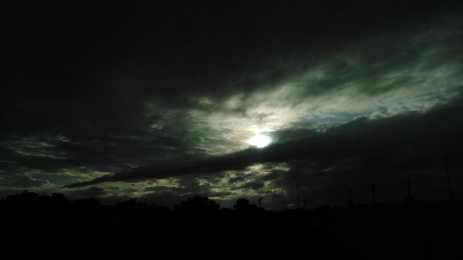 Nature Dramatic Sky Dark Weather No People Beauty In Nature Silhouette Night Scenics Outdoors Tranquility Ethereal Storm Cloud Sky Landscape Tree Thunderstorm Stormy Weather Storm Light Behind Clouds Sunset Sunlight Sunset Silhouettes