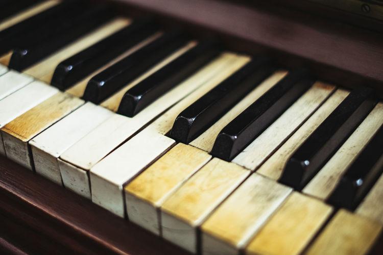 High angle view of weathered piano keys