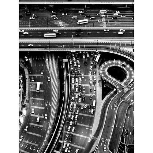 A shining example of anything is possible. All you need is a vision. Dubai. Mydubai Atthetopburjkhalifa Blackandwhite Bnw Citylights Twistyroads Highway Trafficphotography Dubaiinstagram Dubailoving Blackandwhite_perfection Blackandwhiteproject Bhurjkhalifaview Inthemiddleofthedesert Desertnomore Mydubaitrip @dubailoving @mydubai @dubai