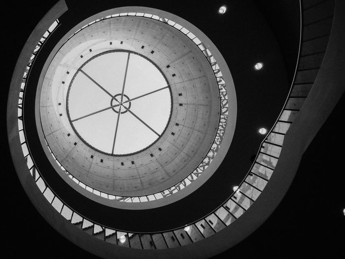 Low angle view of spiral staircase against skylight