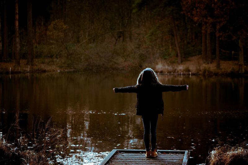 Woman On Jetty By Lake