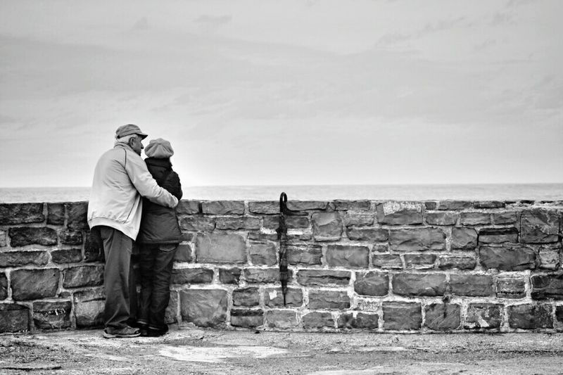 Two People Senior Adult Couple - Relationship Women Senior Women Retirement Adult Senior Men People Outdoors Full Length Men Warm Clothing Flat Cap Senior Couple Togetherness Day Sky