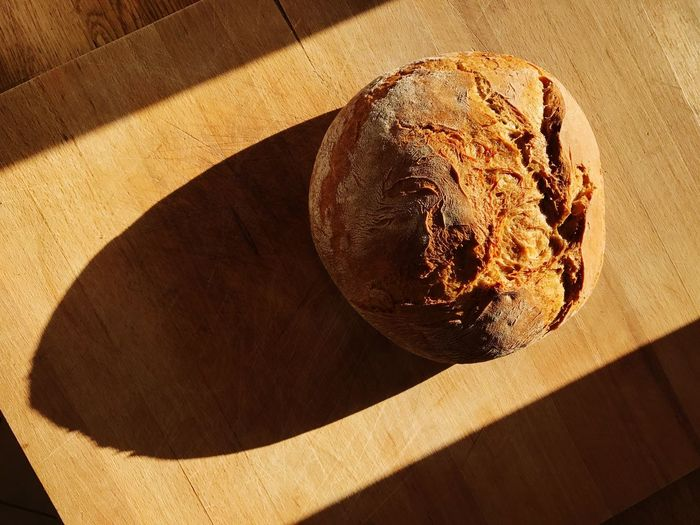 A bread on a wooden board Food Freshness Sunlight Bread Close-up Kitchen Tradition Germany🇩🇪