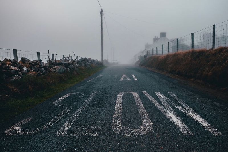 SLOW IN THE MIST EyeEmBestPics Northwales Xe2s The Way Forward Transportation Direction Road Sky Nature Fog Road Marking Diminishing Perspective Sign vanishing point Marking Outdoors Street