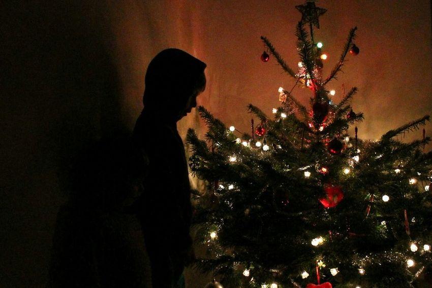 Christmas Christmas Tree Tree Silhouette Night One Person People Indoors  Luminosity Christmas Decoration Christmas Lights