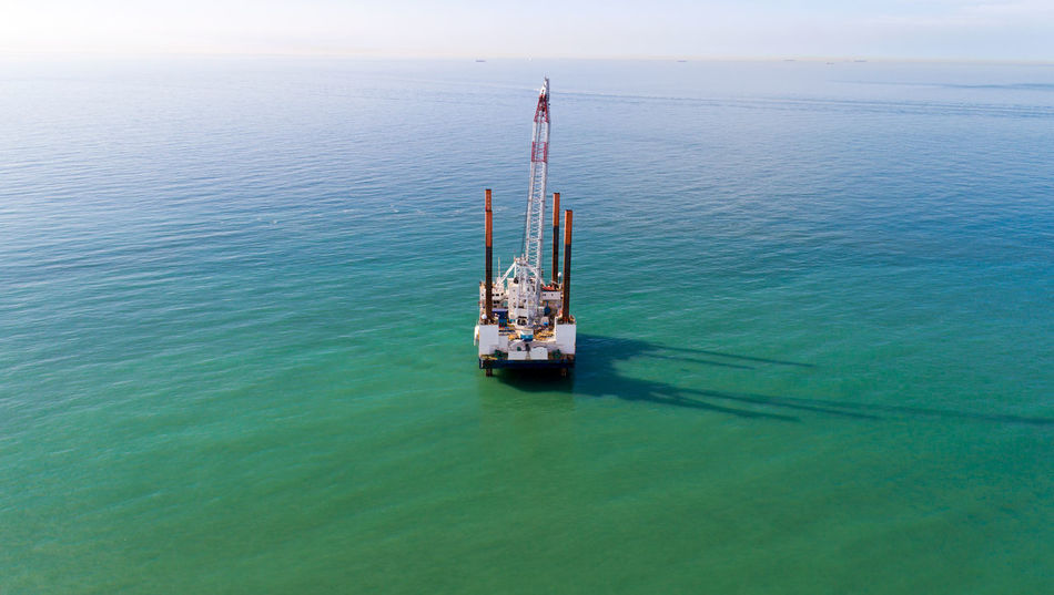 Aerial view of an offshore platform in the Channel sea, Sangatte, France Atlantic Ocean Channel English Channel France Pas De Calais Aerial Photography Aerial View Blue Boat Day Digging Fuel And Power Generation Horizon Over Water Industry No People Offshore Platform Oil Industry Sangatte Sea Ship Sky Transportation Turquoise Vessel Water