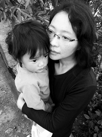 Mother and child This Is Family ❤ EyeEmNewHere Moment Memory Thinking Holding Baby Blackandwhite Emotion Love Feelings Friendship Closeness Hug This Is Family Young Women Child Childhood Bonding Togetherness Women Portrait Females