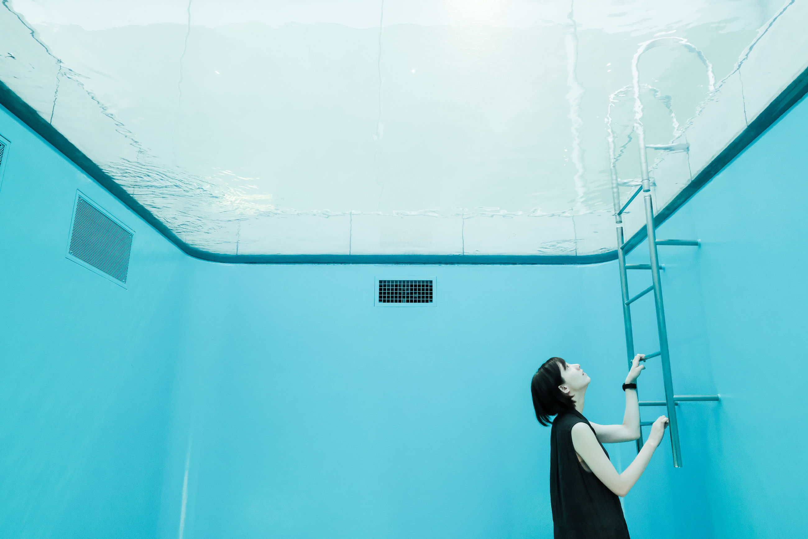 real people, architecture, one person, built structure, lifestyles, leisure activity, day, women, wall - building feature, building exterior, outdoors, technology, standing, men, adult, window, nature, blue, turquoise colored, ceiling