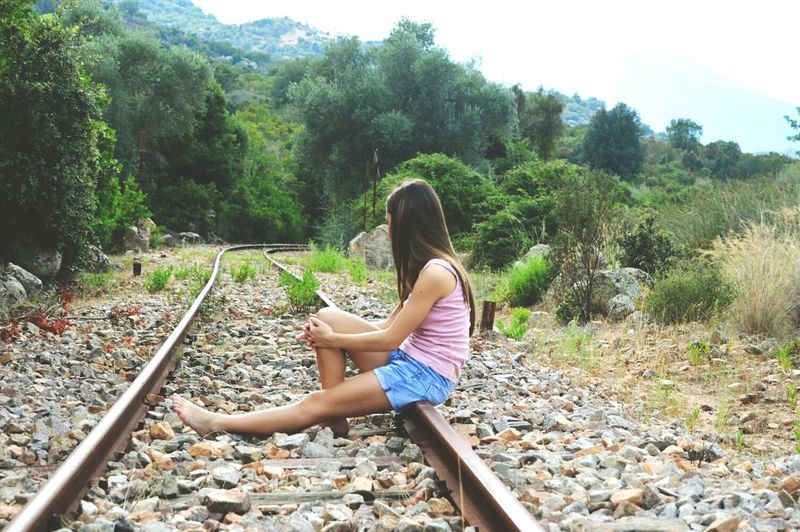 Full Length One Person Tree Day High Angle View Leisure Activity Water Outdoors People Childhood One Woman Only Nature Adult Adults Only Young Adult Train Train Station Traintracks Love ♥ Sardegnaofficial Reflections Streetphotography Outdoors Beauty In Nature Sardegna😍😍👍👌 Train Ride The Street Photographer - 2017 EyeEm Awards