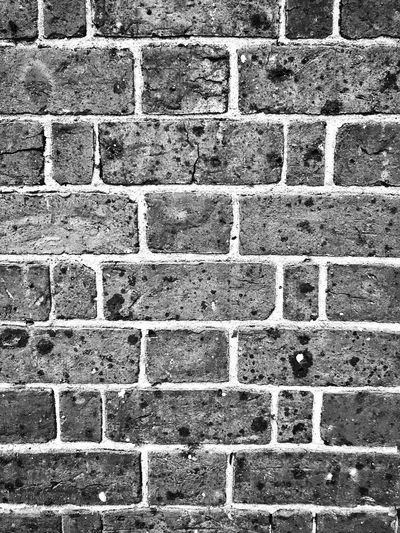 Monochrome brick wall Monocrome Monocrome Design Black And White Brick Wall Close Up Brick Wall Brick Wall Background Full Frame Backgrounds Pattern Day No People Textured  Architecture Built Structure Outdoors In A Row Gray