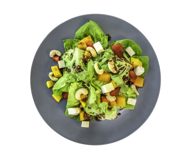 A good taste of mix green salad and fruits on isolated with white background. Healthy meal in fusion style by Thai chili dressing salad. Temptation appetizer dish with a little bit of spicy taste. Dish Isolated Mango Bowl Cashew Delicious Feta Cheese Food Food And Drink Freshness Fruit Garnish Healthy Eating Healthy Food Mountain Nutrition Plate Salad Still Life Strawberry Taste Vegetable Vegetarian Food White Background Yummy