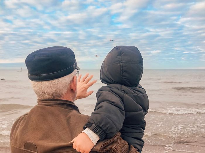 Land Two People Sky Men Togetherness Beach Nature Emotion Adult Child Leisure Activity Real People Positive Emotion Cloud - Sky Sand Love Males  People Son Water