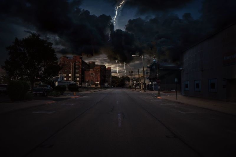 Lightning striking on road during night