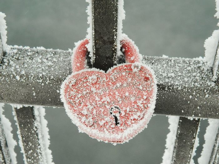 High Angle View Of Love Lock On Railing During Winter